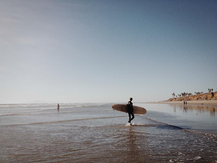 iphone photo of surfer WhiteOnRiceCouple.com