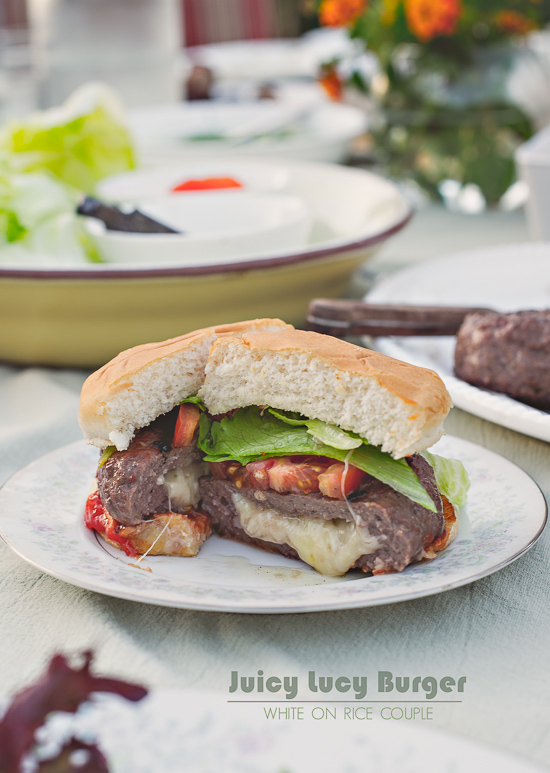 The Juicy Lucy Burgers are cheddar stuffed burgers with melted cheese oozing from the center of the patty. Recipe from White On Rice Couple