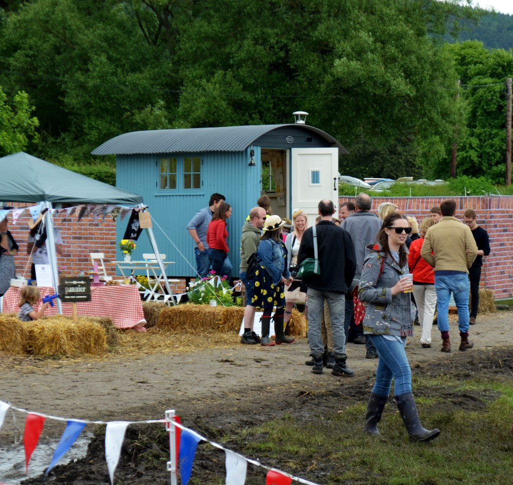 shepherd hut with crowd around it