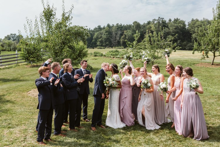 Bridal party enjoying some fun in the peach orchard at White Pine Grove