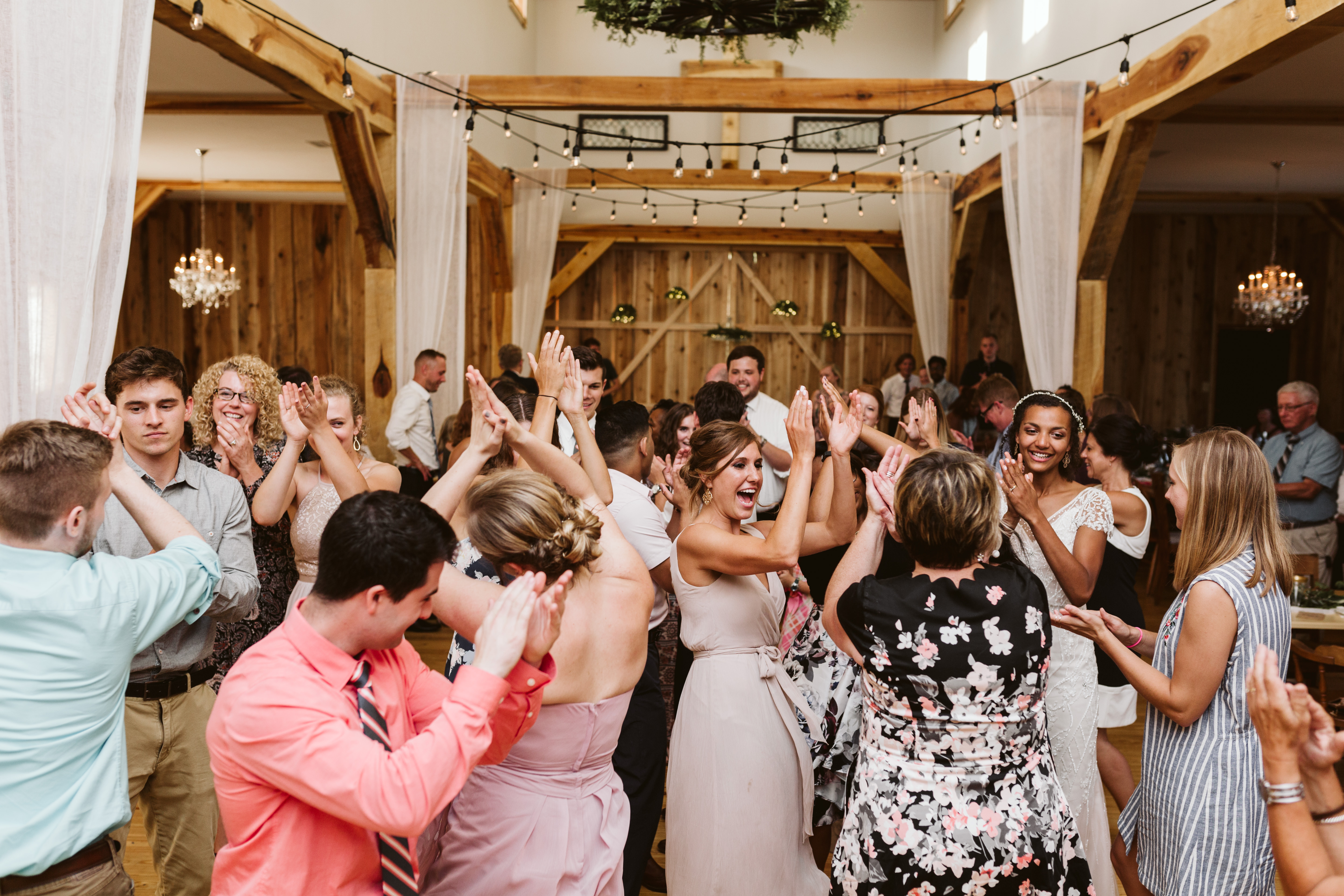 Guests having a blast on the dance floor at White Pine Grove!