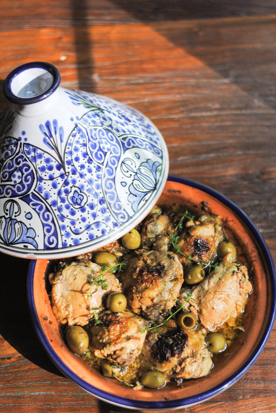 Moroccan chicken tagine white plate blank slate a classic moroccan chicken tagine with preserved lemon and green olives full of flavor with onion garlic saffron ginger and cilantro forumfinder Choice Image