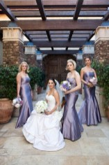 The bride and her bridesmaids and their flower bouquets