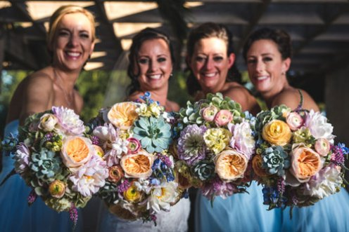 Bridal bouquets with garden roses, ranunculus, succulent and dahlias