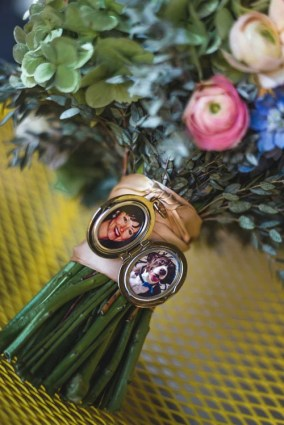 Locket tied to the stem of a bridal bouquet