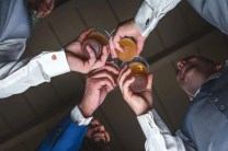 3 groomsmen toasting the groom