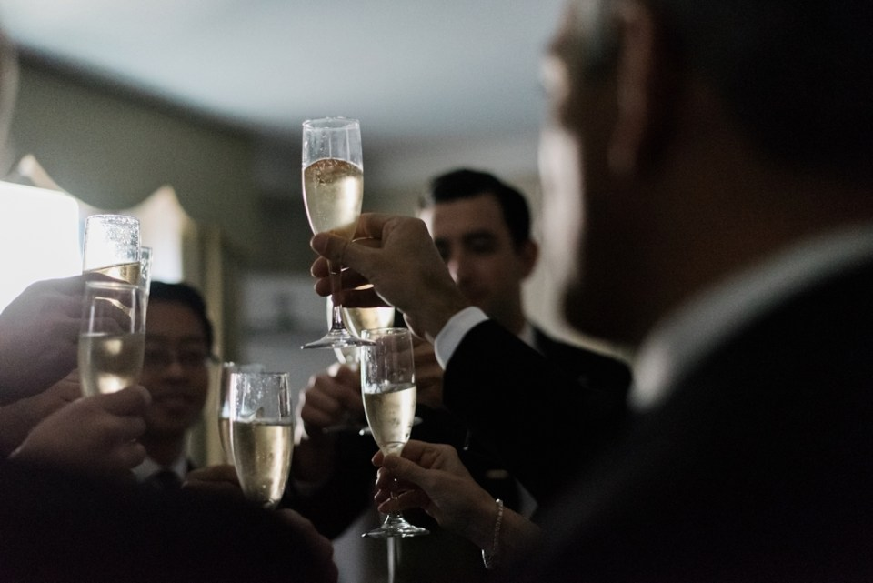 Groomsmen toasting at the Palmer House in Chicago IL