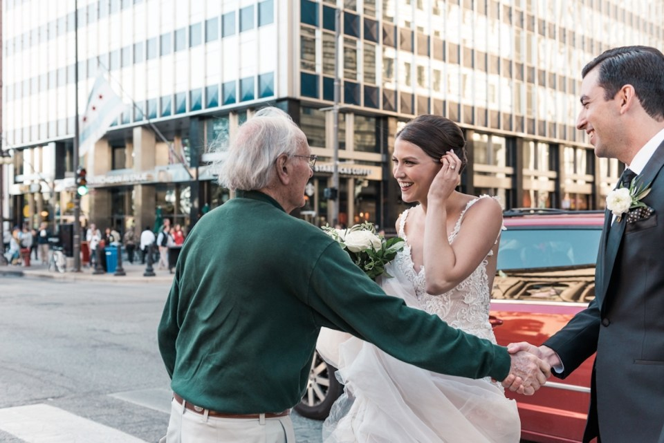 Groom shaking his grandfather-in-law's hand