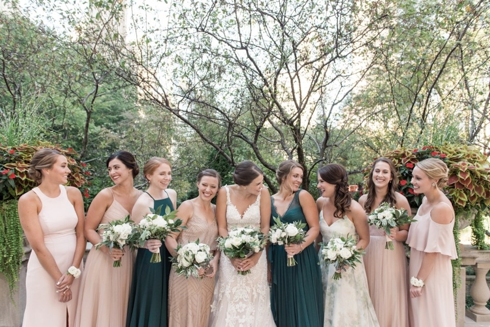 Candid photo of the bridesmaids in the Art Institute of Chicago North Gardens