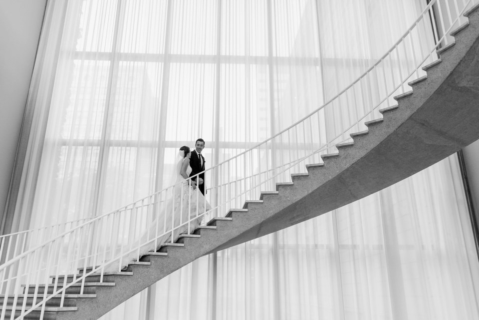 Bride and Groom climbing a staircase at the Art Institute of Chicago