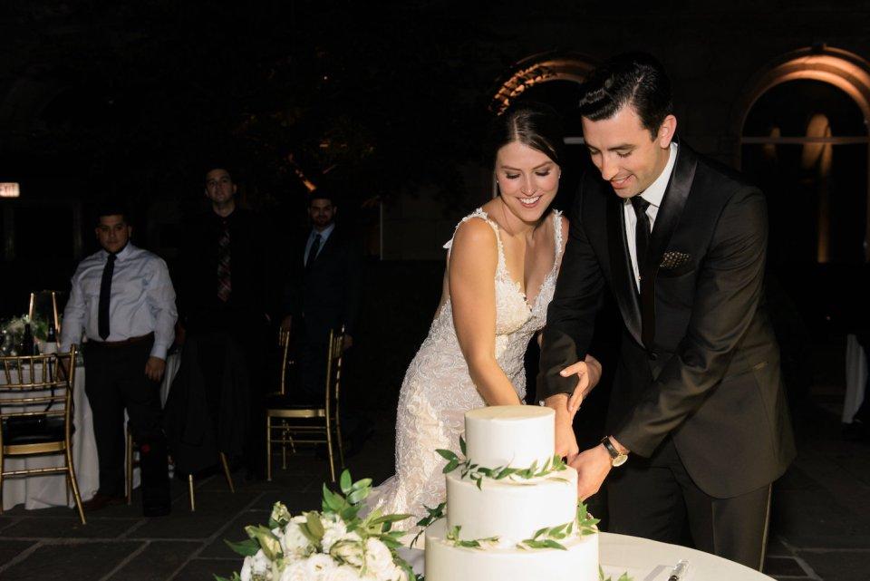 Couple cutting their wedding cake