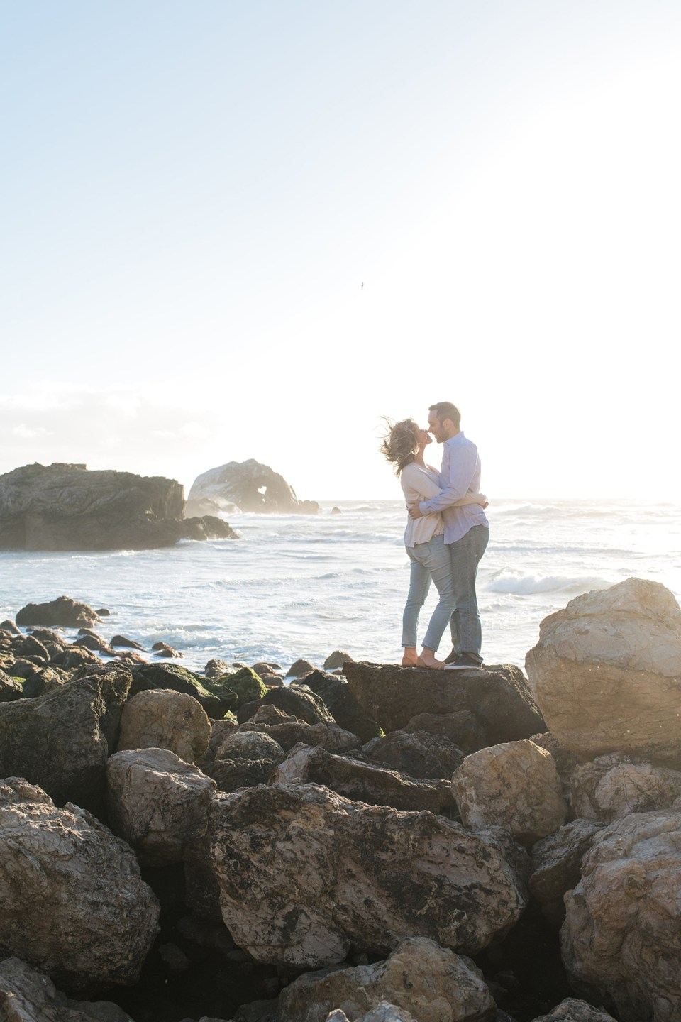 Couple kissing on a windy day at Sutro Baths in San Franscico