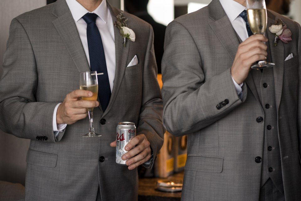 Groomsmen with their drinks at the W Hotel Lakeshore