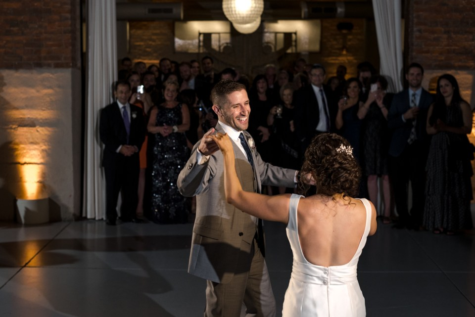 Couple shares their first dance at Artifact Events in Ravenswood