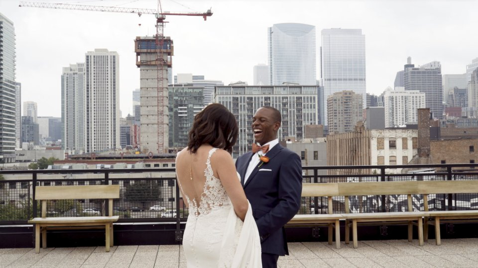 Bride and groom share a first look on Ace Hotel's rooftop in Chicago, IL