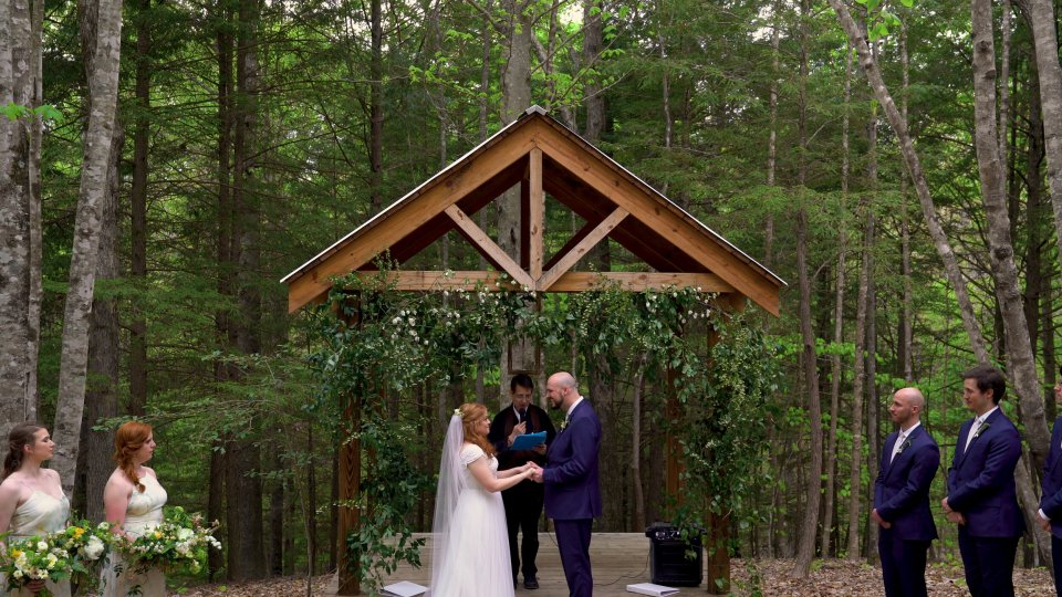 Bride and Groom exchange vows in a grove of hemlock trees in Red River Gorge's Events at Hemlocks Springs.