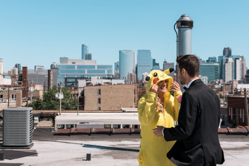 Bride surprises the groom with a Pokemon onesie during the first look on their wedding day