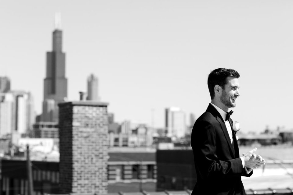 Groom waits for the real first look with the Chicago skyline in the background