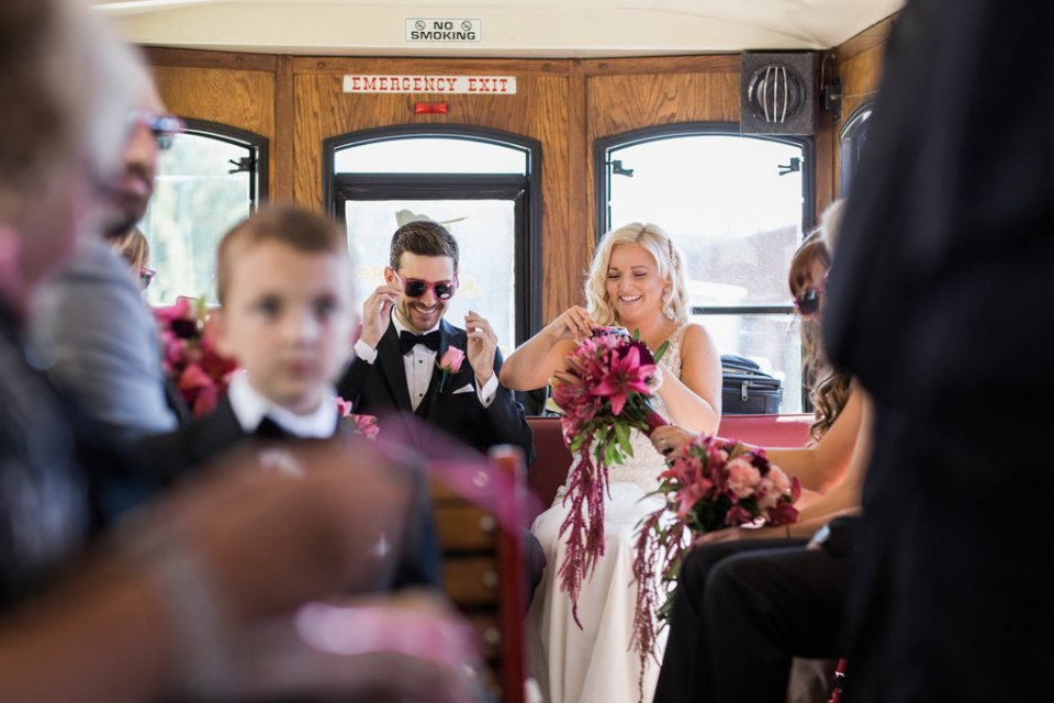 Bride and Groom on a trolley with their wedding party