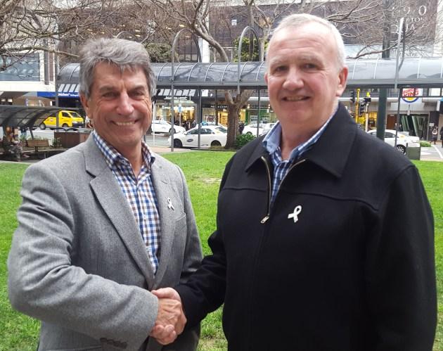 Judge Peter Boshier congratulates new White Ribbon Advisory Committee Chair Cam Ronald
