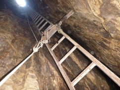 Top ladder on entrance pitch, Rana Hole (Photo - Andy Cole)
