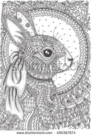 hand drawn rabbit with ethnic floral doodle pattern
