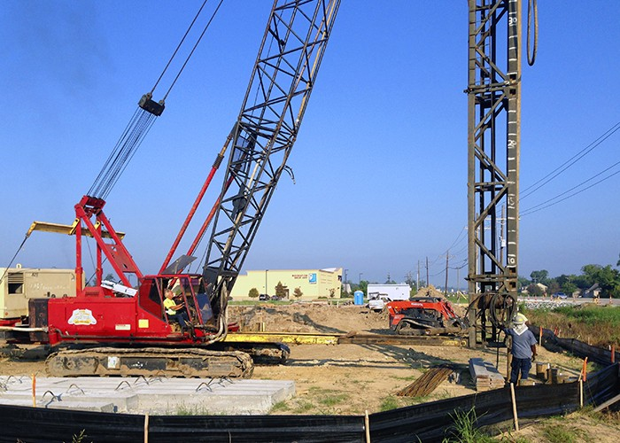 Installation of 40′ timber piles, installed for sign foundation. Baton Rouge, LA