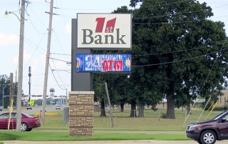 Flag mounted pole sign with electronic message center. New Boston, TX