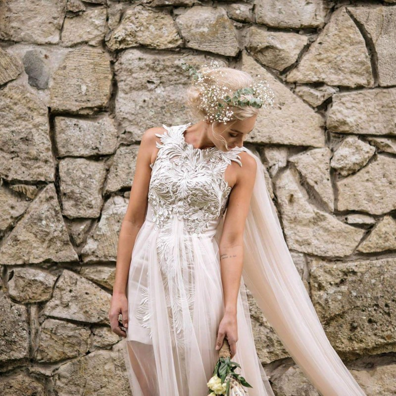 A woman in a designer bridal gown looks down following her real wedding