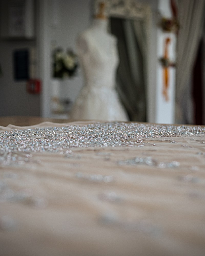 Close up of bridal gown lace in a bridal gown boutique
