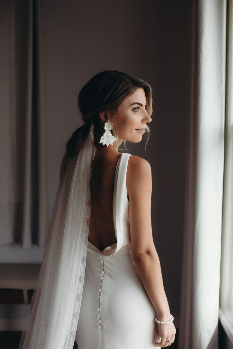 A woman in a White Silk Bridal Couture bridal gown