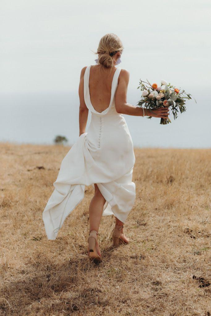 A woman runs in a bridal gown