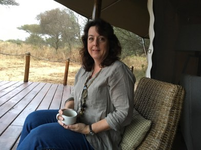Coffee on the porch of their 'tent' on safari