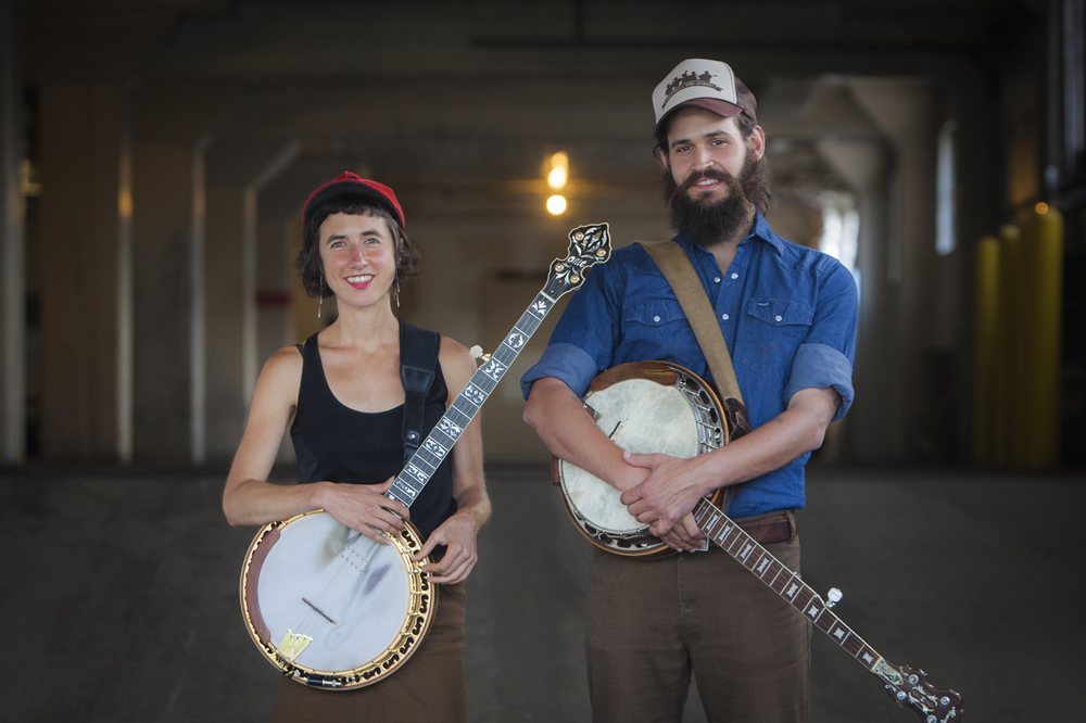 Folk duo, The Lowest Pair, pose with their banjos outside the White Wall in Sioux Falls
