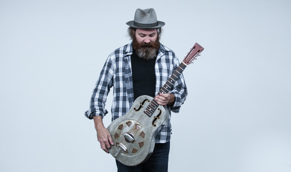 Lou Shields poses with his dobro at the White Wall Studio