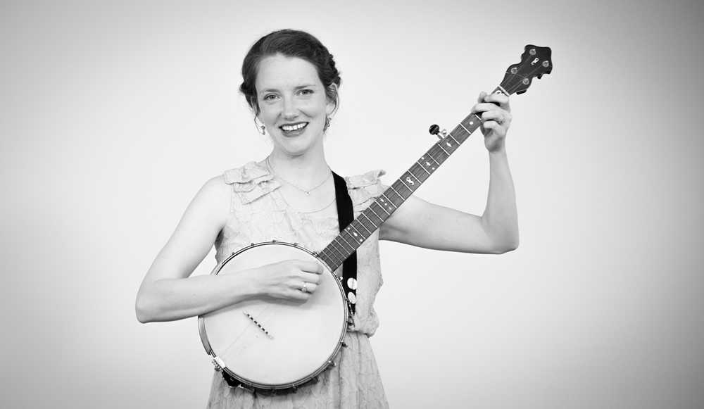 Eliza Blue smiling with her banjo at The White Wall Sessions in Sioux Falls.
