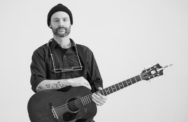 Seattle singer songwriter, Rocky Votolato, poses with his acoustic guitar at The White Wall Sessions in Sioux Falls