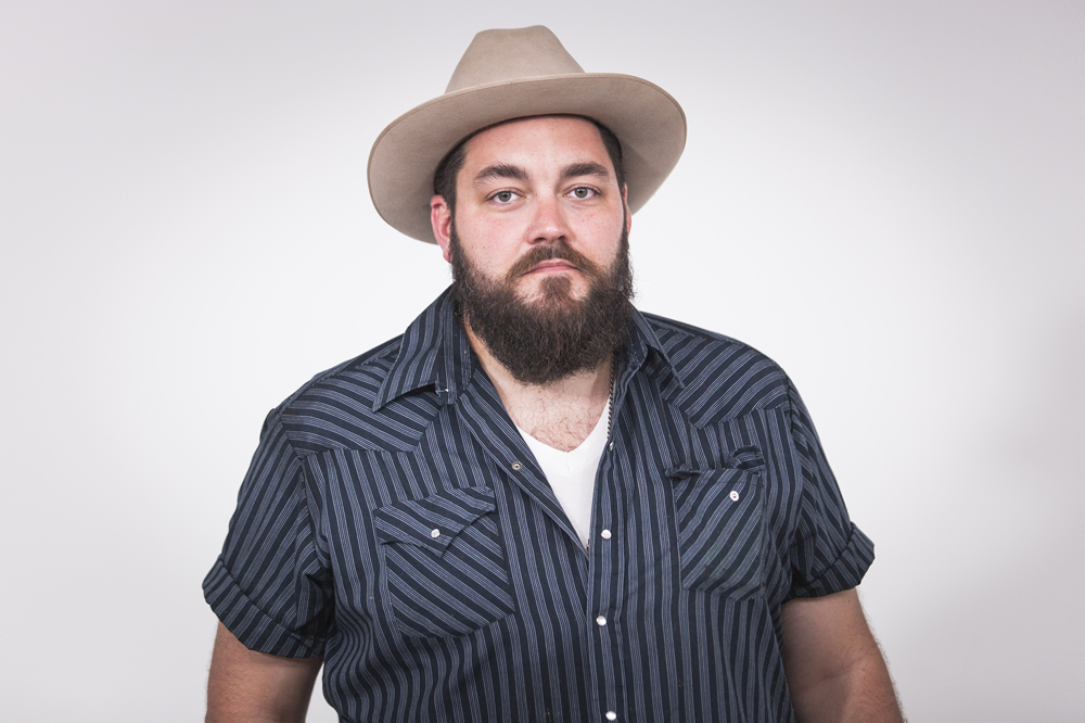 Cherokee, IA's J. Jeffrey Messesrole posing in a cowboy at The White Wall Sessions in Sioux Falls.