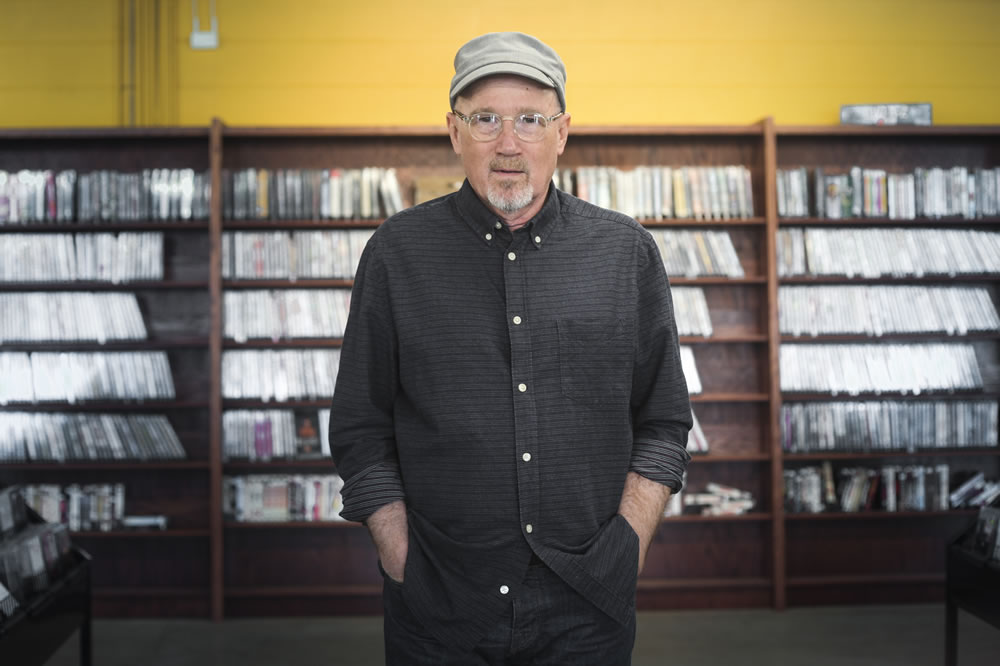 Marshall Crenshaw posing at Last Stop CD Shop in Sioux Falls, SD.