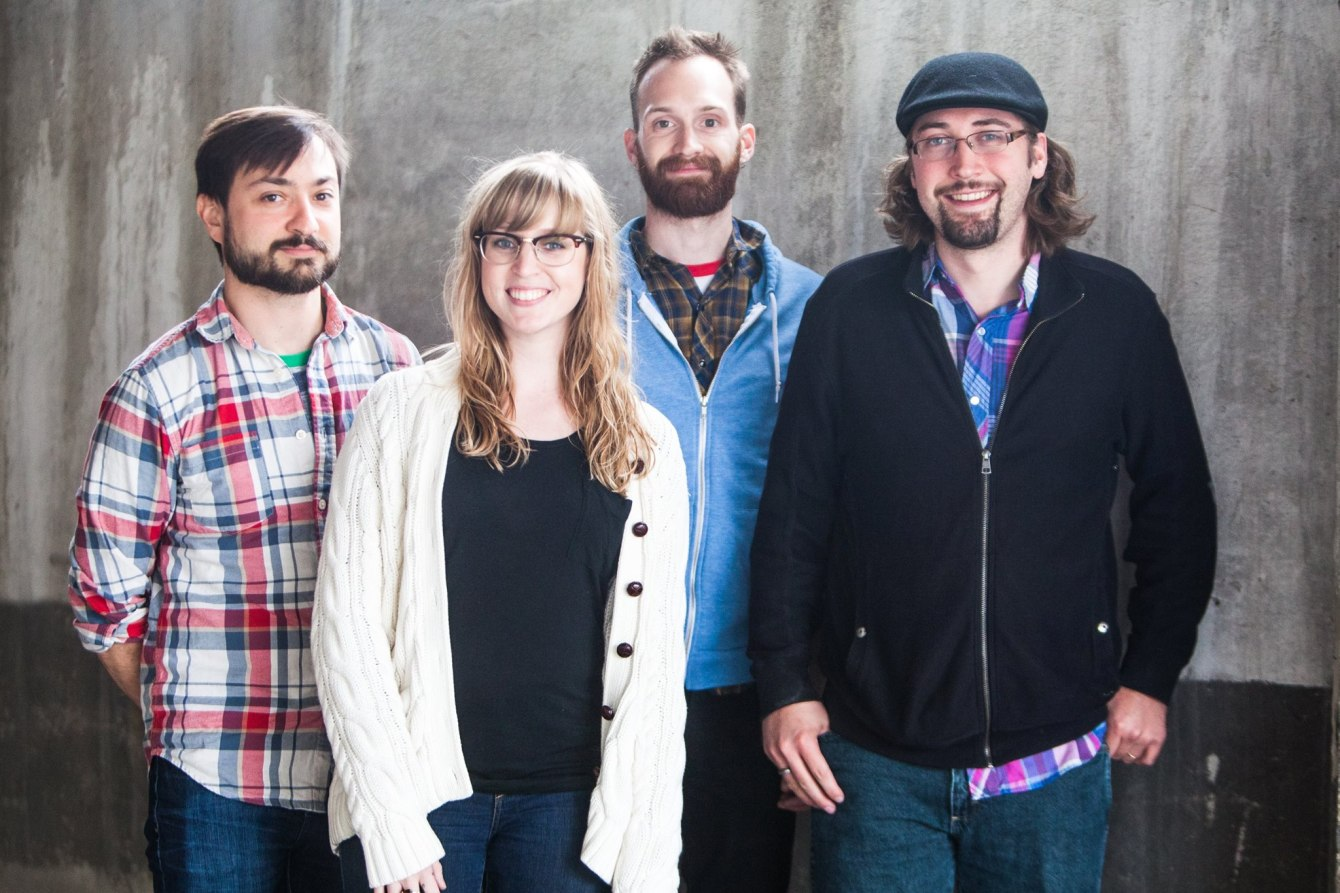 4 members of Jillian Rae pose outside the White Wall studio in Sioux Falls