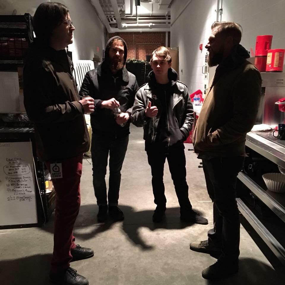 A shadowy shot of the 4 members of Lot Lizard backstage