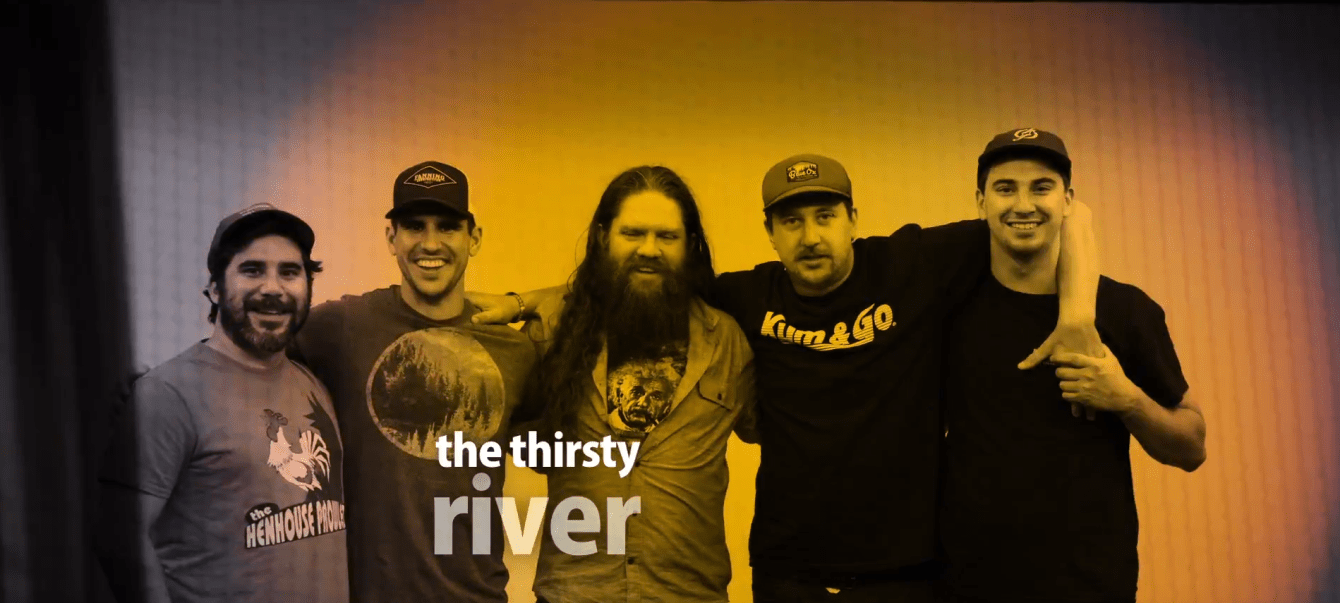 5 members of Minneapolis' The Thirsty River lock arms at the White Wall studio in Sioux Falls