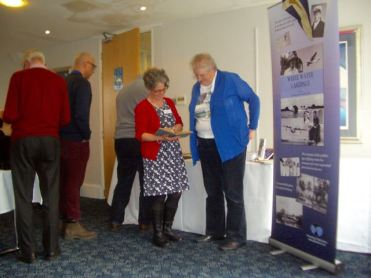 Talking at White Water Landings book display