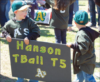 The WBSA Opening Day parade was Saturday, April 25. It was the first year teams for 4-year-olds were included in Whitman. Zachary, left, and Tyler Foster, both 4, prepare for a banner day at the Hanson Little League parade.