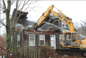 Whitman razes blighted house