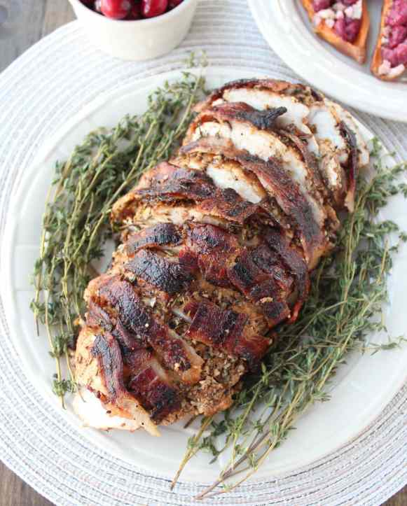 This bacon wrapped turkey breast is covered in a balsamic garlic herb rub then wrapped in a bacon weave for a flavorful, juicy turkey recipe!