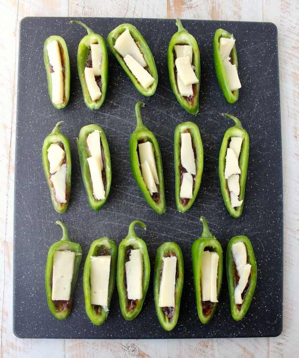 Bacon jam and triple creme cheese fill fresh jalapenos in this delicious and easy jalapeno poppers recipe, perfect for a dinner or party appetizer!