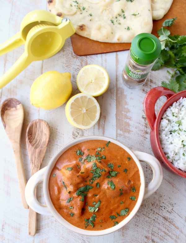 This 30 Minute Indian Butter Chicken recipe is a quick & easy twist on a classic Indian dish that's perfect served with cilantro rice & garlic naan!
