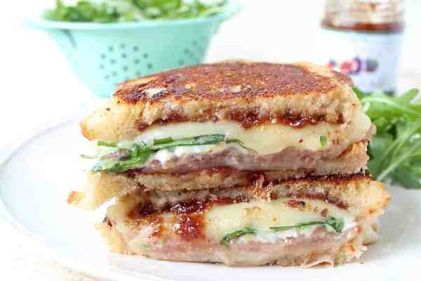 This Provolone Grilled Cheese Sandwich recipe is filled with prosciutto, blue cheese, arugula & fig jam for a flavorful, delicious & filling sandwich!
