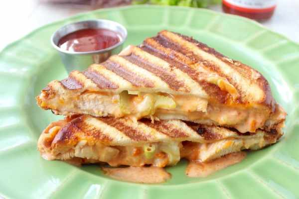 Hot sauce sautéed chicken, pepper jack cheese and a spicy, creamy sauce make up this deliciously saucy and cheesy Spicy Chicken Panini recipe!